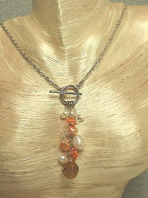 #F127Orange and white pendant necklace